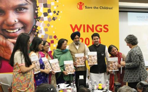 "Smt. Lalitha Kumaramangalam, Chairperson, NCW with Dr. Nazma Heptulla (Hon'ble Minister for Minority Affairs) and other dignitaries release the book ""WINGS 2014 - World of India's Girls"""