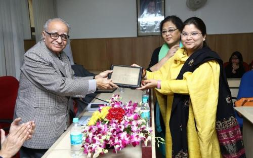 Ms. Hemlata Kheria and Ms. Laldingliani Sailo presenting the momento to Shri T. Chatterjee, Chairman, IIPA