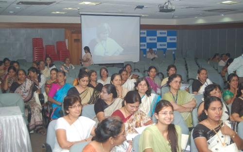 View of participants and screen showing telecast through 'video conferencing'